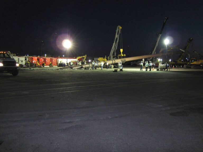 Workers at night installing new water line for Elizabeth River Crossing