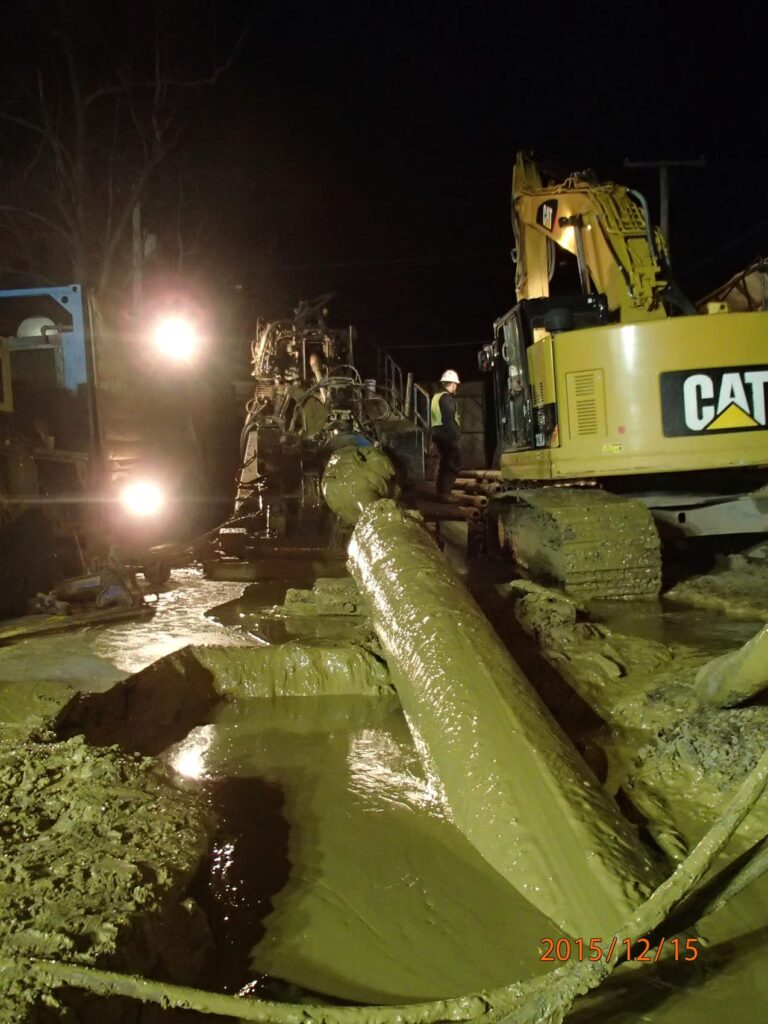 HDD crew working around the clock to pull HDPE pipe