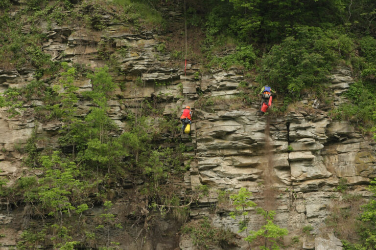 Geologists mapping rock face