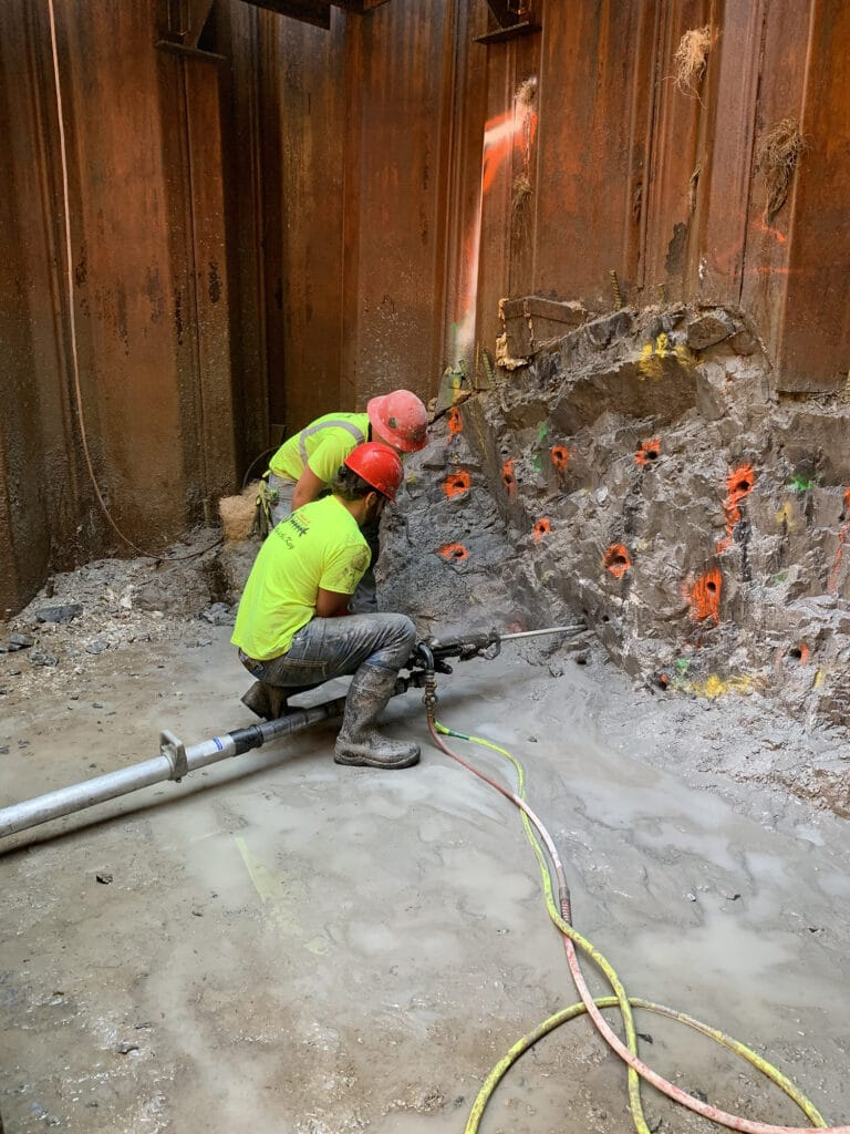 Drilling in sandstone for Drill and Blast tunneling beneath railroad in Dover, NH- Brierley Associates