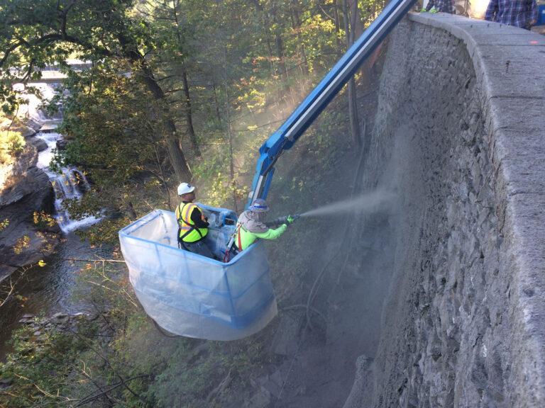 Applying Shot-Crete to repair retaining wall