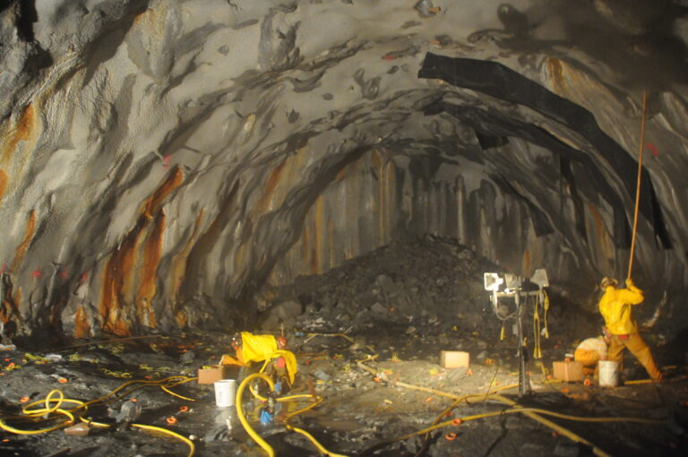 Loading explosives for drill and blast excavation of starter tunnel