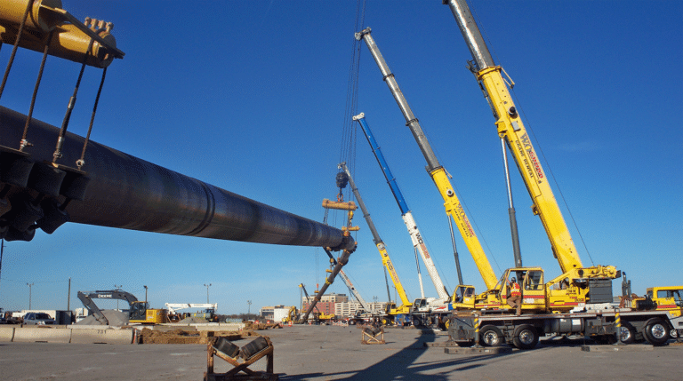 Cranes suspending pipe for HDD installation